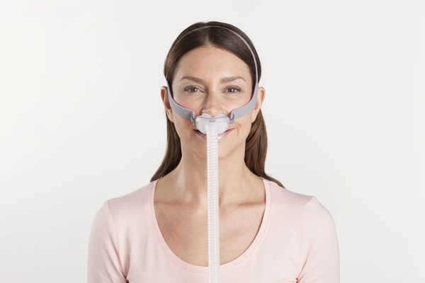 resmed airfit p10 nasal pillow mask on model from front