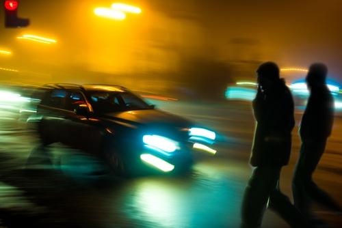 pedestrians-walking-at-night-near-traffic.jpg