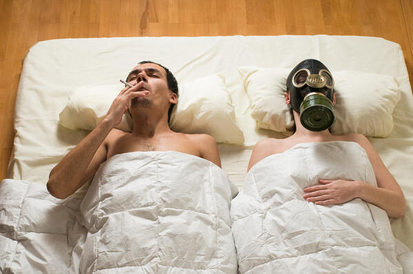 smoking in bed with faux sleep apnea mask